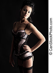 black hair - Beautiful young woman in lingerie over black...