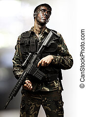 young soldier with rifle - portrait of young soldier posing...