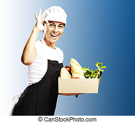 woman carrying groceries - portrait of middle aged woman...