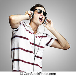 man listening music - portrait of a handsome young man...