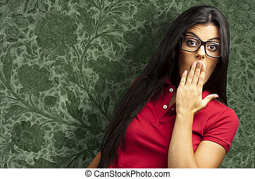 woman covering her mouth - portrait of young woman covering...