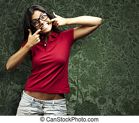 happy woman gesturing - portrait of a happy young woman...