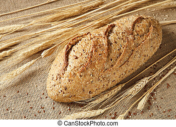 Whole Grain Bread Loaf Photographed on Burlap