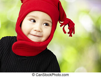 portrait of an adorable kid smiling wearing winter clothes...