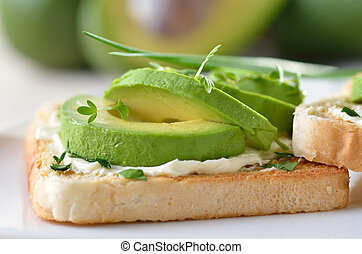 Avocado on toast - Toast with cream cheese, ripe avocado and...