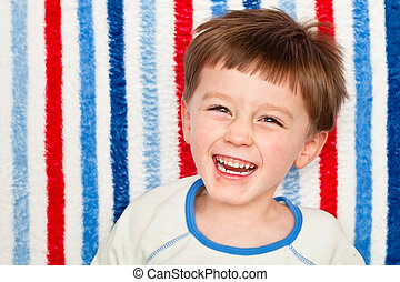 Laughing child - A cute four year old boy laughing