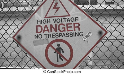 High Voltage - A sign warns of the danger of electrocution...