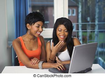 Girls socializing on internet - Girls socializing or...