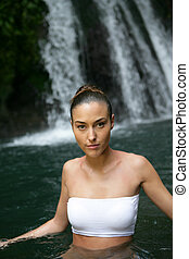 Woman in front of a waterfall