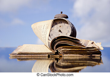 antique book on mirror and wind