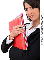 Young businesswoman holding folders