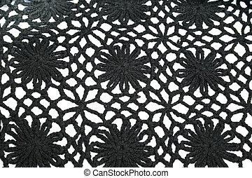 Knitwear - Black ornate knitwear as a  background.