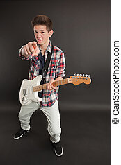 Male with a guitar pointing at you
