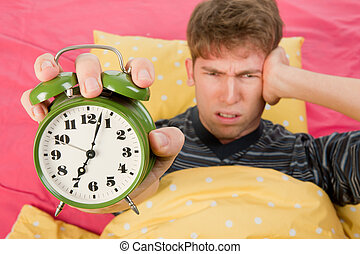 Wake up man - man is waking up with alarm clock with bells