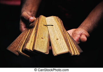 Book of papyrus - Prayer book of papyrus in the hands of...