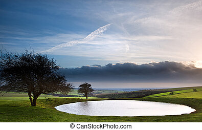 Dramatic sky over countryside landscape with naturally...