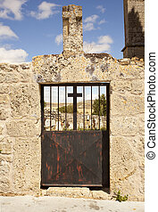 Iron gate of a cemetery - Iron gate of an old cemetery -...