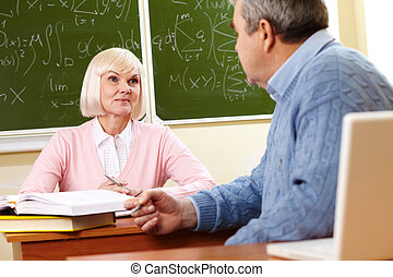 Consulting with teacher - Portrait of mature man speaking to...
