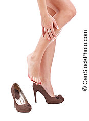 woman rubbing her legs over white background
