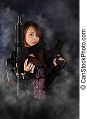 freestyle woman posing with guns - Shot of a sexy freestyle...