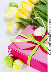 easter eggs with yellow tulip flowers and gift box