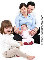 Unhappy jealous little girl with family - Unhappy jealous...