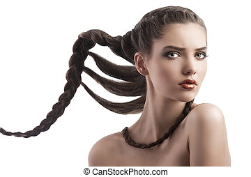 beauty face shot of a brunette with a creative hairstyle