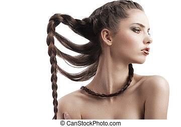 beauty portrait of a beautiful brunette with a braid
