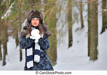 Young Beautiful Woman in winter time
