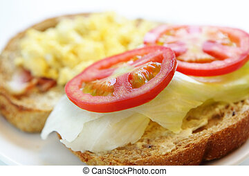 delicious breakfast include egg, tomato and toast