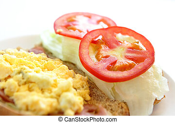 delicious breakfast include egg, tomato , toast