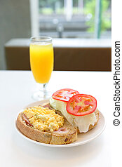 delicious breakfast include egg, tomato , toast and orange juice, good for health