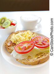delicious breakfast include egg, tomato , toast and coffee