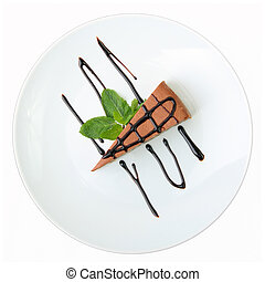 piece of chocolate cheesecake with mint petal on a white...