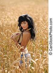 Topless Woman In Wheatfield. Seductive topless woman...