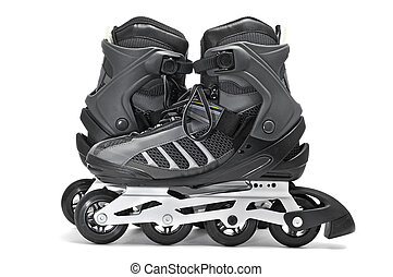 inline skates - a pair of inline skates on a white...