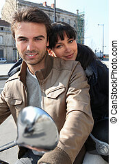 Couple on a moped