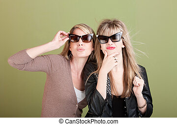 Gazing Mom and Daughter - Mom and daughter with sunglasses...