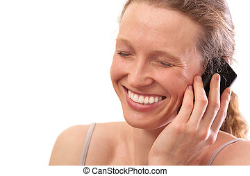 Woman smiling and talking on the telephone