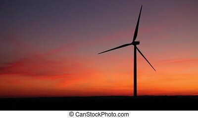 windmill at sunset in red background