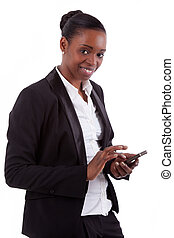 Smiling african american businesswoman using a smartphone,...