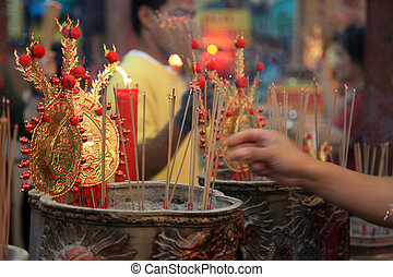 BANGKOK - JANUARY 23 : Chinese New Year 2012 - Man places...