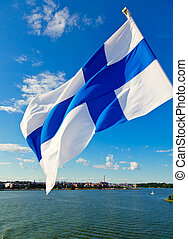 Waving Finnish Flag - Flag of Finland against Helsinki...