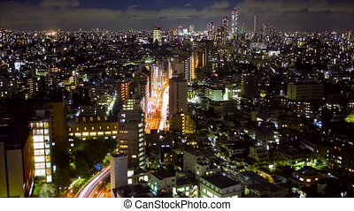 Downtown Tokyo at night, time lapse, view from above