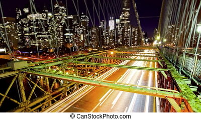 Brooklyn Bridge and New York City skyline at night, time...