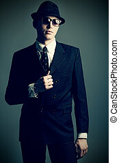 danger - Portrait of a handsome young man in a suit. Shot in...