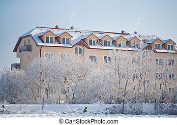 Apartment building - View of snowy apartment building in a...