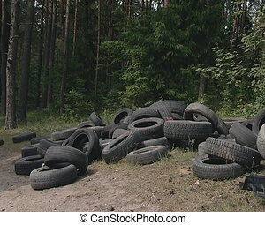Used tires dumped in outskirts Nature pollution - Used tires...