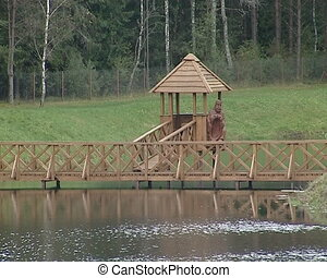 Bridge and bower over lake. Recreation in nature.