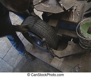 Dismantling tire. Car care industry. - Dismantling of tire...